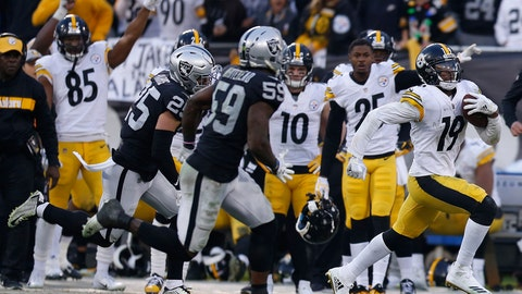 <p>               Pittsburgh Steelers wide receiver JuJu Smith-Schuster (19) runs in front of Oakland Raiders linebacker Tahir Whitehead (59) and defensive back Erik Harris (25) during the second half of an NFL football game in Oakland, Calif., Sunday, Dec. 9, 2018. (AP Photo/D. Ross Cameron)             </p>