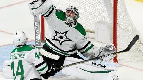 <p>               Dallas Stars goaltender Anton Khudobin (35), of Kazakhstan, deflects a Nashville Predators shot during the second period of an NHL hockey game Thursday, Dec. 27, 2018, in Nashville, Tenn. The Stars won 2-0. (AP Photo/Mark Zaleski)             </p>