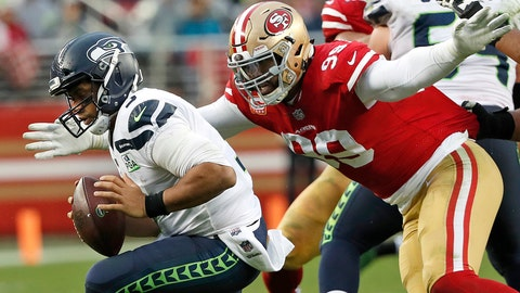 <p>               FILE - In this Sunday, Dec. 16, 2018, file photo, San Francisco 49ers defensive end DeForest Buckner (99) sacks Seattle Seahawks quarterback Russell Wilson (3) during the second half of an NFL football game in Santa Clara, Calif. Generating pressure on the quarterback has never been a major problem for Buckner since entering the NFL in 2016. Turning that pressure into sacks, however, was missing his first two seasons with the 49ers.(AP Photo/Tony Avelar, File)             </p>