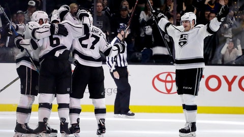 <p>               Members of the Los Angeles Kings celebrate after scoring a gaol by defenseman Alec Martinez during the third period of an NHL hockey game against the Carolina Hurricanes in Los Angeles, Sunday, Dec. 2, 2018. The Kings won 2-0. (AP Photo/Chris Carlson)             </p>