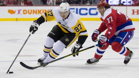 <p>               Pittsburgh Penguins center Sidney Crosby (87) gets away from Washington Capitals right wing T.J. Oshie (77) in the first period of an NHL hockey game, Wednesday, Dec. 19, 2018, in Washington. (AP Photo/Alex Brandon)             </p>