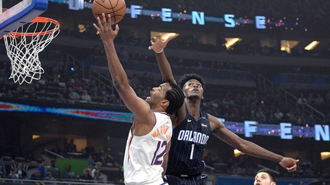 <p>               Phoenix Suns forward T.J. Warren (12) is fouled by Orlando Magic forward Jonathan Isaac (1) while going up for a shot during the first half of an NBA basketball game Wednesday, Dec. 26, 2018, in Orlando, Fla. (AP Photo/Phelan M. Ebenhack)             </p>