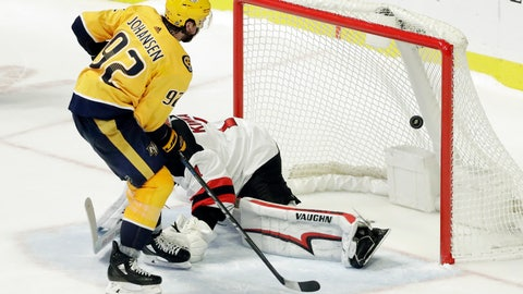 <p>               Nashville Predators center Ryan Johansen (92) scores the winning goal against New Jersey Devils goaltender Keith Kinkaid (1) during a shootout at an NHL hockey game Saturday, Dec. 15, 2018, in Nashville, Tenn. (AP Photo/Mark Humphrey)             </p>