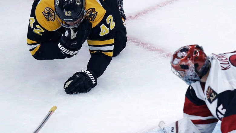 Bruins' David Backes takes skate to face, returns