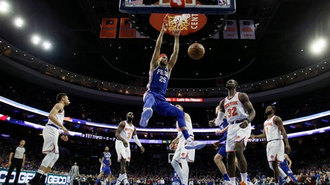 <p>               Philadelphia 76ers' Ben Simmons (25) hangs on the rim after a dunk as New York Knicks' Noah Vonleh (32) looks on during the first half of an NBA basketball game, Wednesday, Dec. 19, 2018, in Philadelphia. (AP Photo/Matt Slocum)             </p>