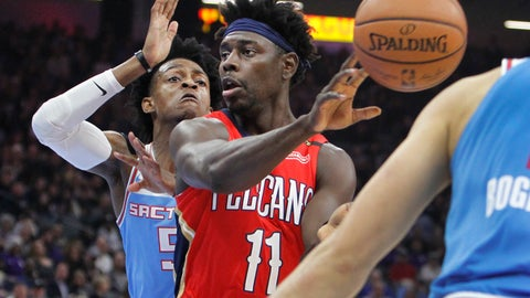 <p>               New Orleans Pelicans guard Jrue Holiday (11) passes the ball against Sacramento Kings guard De'Aaron Fox (5) during the first half of an NBA basketball game in Sacramento, Calif., Sunday, Dec. 23, 2018. (AP Photo/Steve Yeater)             </p>