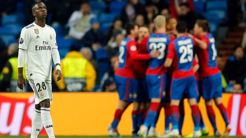 <p>               Real forward Vinicius Junior looks up as CSKA players celebrate in background their side's third goal, during the Champions League, Group G soccer match between Real Madrid and CSKA Moscow, at the Santiago Bernabeu stadium in Madrid, Spain, Wednesday Dec. 12, 2018. (AP Photo/Paul White)             </p>