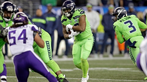 <p>               Seattle Seahawks' Rashaad Penny, center, carries against the Minnesota Vikings in the first half of an NFL football game, Monday, Dec. 10, 2018, in Seattle. (AP Photo/Stephen Brashear)             </p>