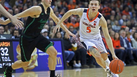 <p>               Virginia's guard Kyle Guy (5) drives past Marshall's Jon Elmore (33) during the second half of an NCAA college basketball game on Monday, Dec. 31, 2018, in Charlottesville, Va. Virginia beat Marshall 100-64. (AP Photo/Zack Wajsgras)             </p>