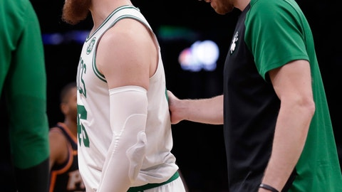 <p>               Boston Celtics center Aron Baynes, left, gets a pat on the back from Gordon Hayward after breaking his left hand during the first quarter of a basketball game against the Phoenix Suns in Boston, Wednesday, Dec. 19, 2018. (AP Photo/Charles Krupa)             </p>