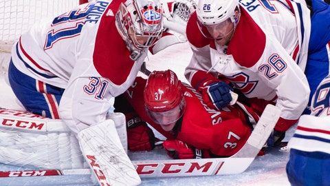 <p>               Carolina Hurricanes' Andrei Svechnikov is pushed to the ice by Montreal Canadiens goaltender Carey Price and defenseman Jeff Petry during the second period of an NHL hockey game, Thursday, Dec. 13, 2018 in Montreal. (Paul Chiasson/The Canadian Press via AP)             </p>