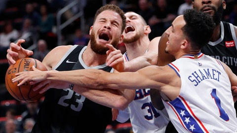 <p>               Detroit Pistons forward Blake Griffin (23) is fouled by Philadelphia 76ers forward Mike Muscala (31) as Landry Shamet (1) defends in the first half of an NBA basketball game in Detroit, Friday, Dec. 7, 2018. (AP Photo/Paul Sancya)             </p>