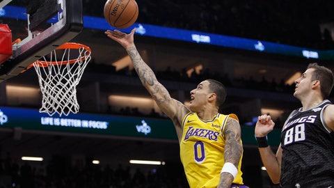 <p>               Los Angeles Lakers forward Kyle Kuzma (0) shoots next to Sacramento Kings forward Nemanja Bjelica (88) during the first half of an NBA basketball game in Sacramento, Calif., Thursday, Dec. 27, 2018. (AP Photo/Steve Yeater)             </p>