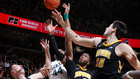 <p>               Iowa's Joe Wieskamp, left, Isaiah Moss (4) and Ryan Kriener, right, and Michigan State's Nick Ward (44) battle for a rebound during the first half of an NCAA college basketball game, Monday, Dec. 3, 2018, in East Lansing, Mich. (AP Photo/Al Goldis)             </p>