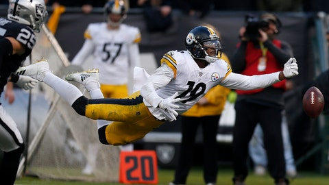 <p>               Pittsburgh Steelers wide receiver JuJu Smith-Schuster (19) cannot catch a pass against the Oakland Raiders during the second half of an NFL football game in Oakland, Calif., Sunday, Dec. 9, 2018. (AP Photo/D. Ross Cameron)             </p>