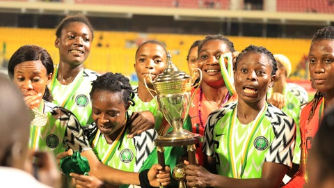 <p>               Nigeria Women female soccer team players celebrates with the trophy after winning against Bayana Bayana of South Africa, at the end of the women Africa Cup of Nations finals in Accra, Ghana, Saturday Dec. 1, 2018. Nigeria won its 11th title in 13 editions of the Women's African Cup of Nations by beating South Africa in a penalty shootout in the final on Saturday. The game ended 0-0 after 120 minutes and although Nigeria missed its first penalty kick in the shootout, when Onome Ebi hit the post, South Africa missed twice and the Nigerians prevailed 4-3. (AP Photo/Alade Omowunmi )             </p>