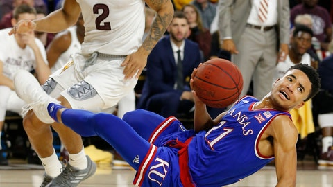 <p>               Kansas guard Devon Dotson (11) loses the ball in front of Arizona State guard Rob Edwards during the first half of an NCAA college basketball game Saturday, Dec. 22, 2018, in Tempe, Ariz. (AP Photo/Rick Scuteri)             </p>