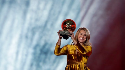 <p>               Olympique Lyonnais' Ada Hegerberg celebrates with the Women's Ballon d'Or award during the Golden Ball award ceremony at the Grand Palais in Paris, France, Monday, Dec. 3, 2018. Awarded every year by France Football magazine since Stanley Matthews won it in 1956, the Ballon d'Or, Golden Ball for the best player of the year will be given to both a woman and a man. (AP Photo/Christophe Ena)             </p>