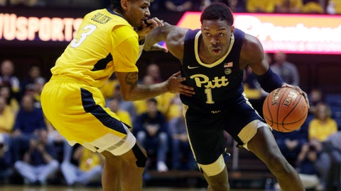 <p>               Pittsburgh guard Xavier Johnson (1) drives past West Virginia guard James Bolden (3) during the first half of an NCAA college basketball game Saturday, Dec. 8, 2018, in Morgantown, W.Va. (AP Photo/Raymond Thompson)             </p>