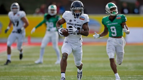 <p>               Utah State wide receiver Jalen Greene (21) sprints to the end zone to score a touchdown ahead of North Texas defensive back Nate Brooks (9) during the first half of the New Mexico Bowl NCAA college football game in Albuquerque, N.M., Saturday, Dec. 15, 2018. (AP Photo/Andres Leighton)             </p>