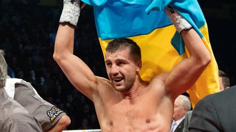 <p>               Oleksandr Gvozdyk raises the Ukrainian flag to celebrate his win over Adonis Stevenson, of Canada, and winning the light heavyweight WBC championship boxing fight, Saturday, Dec. 1, 2018, in Quebec City. (Jacques Boissinot/The Canadian Press via AP)             </p>