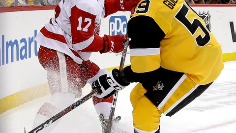<p>               Detroit Red Wings' Filip Hronek (17) clears the puck before Pittsburgh Penguins' Jake Guentzel (59) can get his stick on it during the second period of an NHL hockey game in Pittsburgh, Thursday, Dec. 27, 2018. (AP Photo/Gene J. Puskar)             </p>