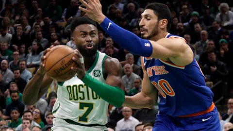 <p>               Boston Celtics guard Jaylen Brown (7) drives against New York Knicks center Enes Kanter (00) during the first quarter of an NBA basketball game Thursday, Dec. 6, 2018, in Boston. (AP Photo/Elise Amendola)             </p>