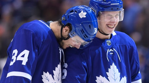 <p>               Toronto Maple Leafs right wing Mitchell Marner (16) and center Auston Matthews (34) laugh after Marner scored a goal against the Florida Panthers and fans threw hats onto the ice during the third period of an NHL hockey game Thursday, Dec. 20, 2018, in Toronto. Fans thought that Maple Leafs' John Tavares had scored, which would have given him a hat trick. (Nathan Denette/The Canadian Press via AP)             </p>