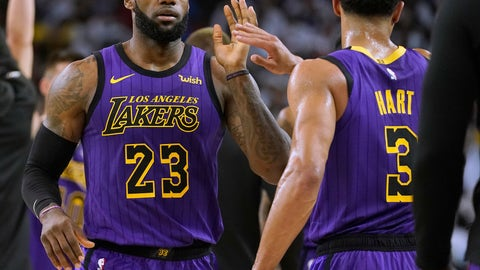 <p>               Los Angeles Lakers forward LeBron James (23) high-fives Josh Hart (3) at the end of the first half of the team's NBA basketball game against the Golden State Warriors on Tuesday, Dec. 25, 2018, in Oakland, Calif. (AP Photo/Tony Avelar)             </p>
