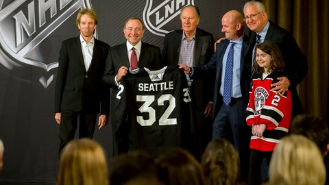<p>               NHL commissioner Gary Bettman, center left, holds a jersey after the NHL Board of Governors announced Seattle as the league's 32nd franchise, Tuesday, Dec. 4, 2018, in Sea Island Ga.. Joining Bettman, from left to right, is Jerry Bruckheimer, David Bonderman, David Wright, Tod Leiweke and Washington Wild youth hockey player Jaina Goscinski. (AP Photo/Stephen B. Morton)             </p>