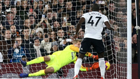 <p>               Fulham's Aboubakar Kamara has a penalty saved by Huddersfield Town goalkeeper Jonas Lossl, during their English Premier League soccer match at Craven Cottage in London, Saturday Dec. 29, 2018. (Yui Mok/PA via AP)             </p>