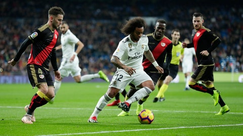 <p>               Real Madrid's Marcelo, center, controls the ball during the Spanish La Liga soccer match between Real Madrid and Rayo Vallecano at the Bernabeu stadium in Madrid, Spain, Saturday, Dec. 15, 2018. (AP Photo/Manu Fernandez)             </p>