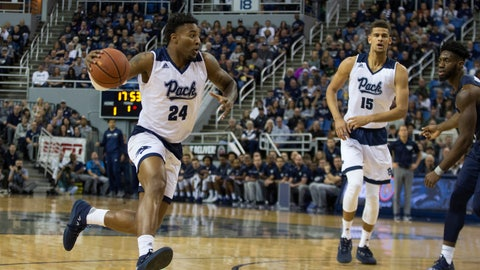 <p>               Nevada's Jordan Caroline (24) drives against Akron in the first half of an NCAA college basketball game in Reno, Nev., Saturday, Dec. 22, 2018. (AP Photo/Tom R. Smedes)             </p>