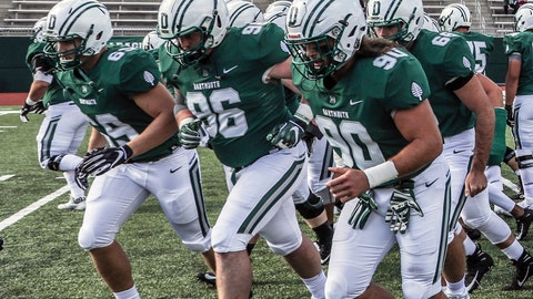 <p>               In this Sept. 29, 2018, photo provided by Dartmouth College, Seth Simmer (96) is flanked by Tommy Ciesla (69) and Niko Lalos (90) during warmups before an NCAA college football game between Dartmouth and Penn in Hanover, N.H. During his freshman season at Dartmouth, Seth Simmer was having trouble hearing the linebackers call signals from his defensive tackle spot just a few yards away. What was first diagnosed as an ear infection brought on by a severe head cold turned out to be a brain tumor that was making him deaf in his left ear. Simmer is one of 30 nominees for the Mayo Clinic Comeback Player of the Year Award. (Tom McNeill/Dartmouth College via AP)             </p>