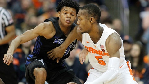 <p>               Syracuse's Jalen Carey, right, tries to dribble past Buffalo's Ronaldo Segu, left, in the first half of an NCAA college basketball game in Syracuse, N.Y., Tuesday, Dec. 18, 2018. (AP Photo/Nick Lisi)             </p>
