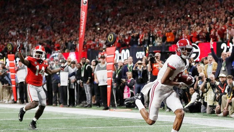 <p>               FILE - In this Jan. 8, 2018, file photo, Alabama wide receiver DeVonta Smith (6) makes a touchdown catch against Georgia during overtime of the NCAA college football playoff championship game in Atlanta. (AP Photo/David Goldman, File)             </p>