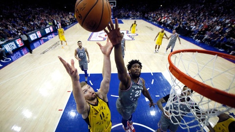 <p>               Indiana Pacers' Domantas Sabonis (11) and Philadelphia 76ers' Joel Embiid (21) leap for a rebound during the second half of an NBA basketball game, Friday, Dec. 14, 2018, in Philadelphia. Indiana won 113-101. (AP Photo/Matt Slocum)             </p>