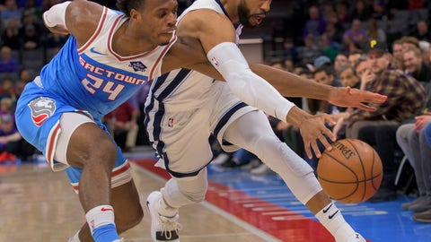<p>               Sacramento Kings guard Buddy Hield (24) and Memphis Grizzlies guard Garrett Temple (17) chase the ball during the first quarter of an NBA basketball game in Sacramento, Calif. Friday, Dec. 21, 2018. (AP Photo/Randall Benton)             </p>