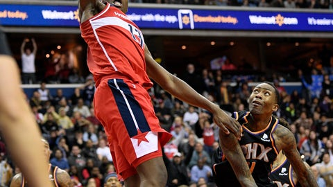 <p>               Washington Wizards center Thomas Bryant (13) dunks over Phoenix Suns guard Jamal Crawford, right, during triple overtime of an NBA basketball game, Saturday, Dec. 22, 2018, in Washington. (AP Photo/Nick Wass)             </p>