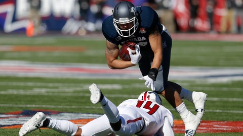 <p>               Nevada tight end Trae Carter-Wells breaks the tackle on Arkansas State defensive back Antonio Fletcher (14) in the first half of the Arizona Bowl NCAA college football game Saturday, Dec. 29, 2018, in Tucson, Ariz. (AP Photo/Rick Scuteri)             </p>