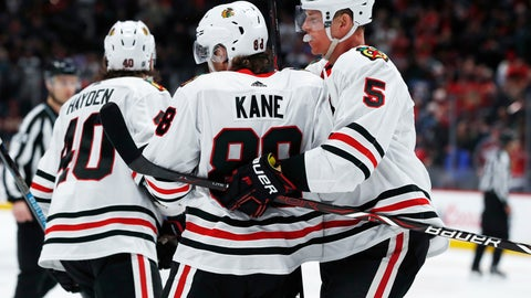 <p>               Chicago Blackhawks defenseman Connor Murphy, right, hugs right wing Patrick Kane, who scored against the Colorado Avalanche in overtime of an NHL hockey game Saturday, Dec. 29, 2018, in Denver. The Blackhawks won 3-2. (AP Photo/David Zalubowski)             </p>