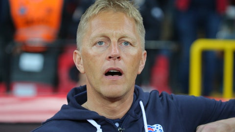 <p>               FILE - In this Friday, Oct. 6, 2017 file photo, Iceland's Iceland head coach Heimir Hallgrimsson sings his country's national anthem, prior to the World Cup Group I qualifying soccer match between Turkey and Iceland in Eskisehir, Turkey. Iceland's coach at the World Cup, part-time dentist Hallgrimsson, has been hired by Qatari club Al-Arabi. Al-Arabi announced the move in a video on its Twitter account, and says Hallgrimsson will attend a news conference Tuesday, Dec. 11, 2018. (AP Photo, File)             </p>