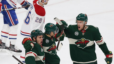 <p>               Minnesota Wild's Nino Niederreiter of Switzerland, middle, celebrates with teammates Zach Parise, left, and Charlie Coyle, right, after Niederreiter scored a goal against the Montreal Canadiens in the first period of an NHL hockey game, Tuesday, Dec. 11, 2018, in St. Paul, Minn. (AP Photo/Stacy Bengs)             </p>