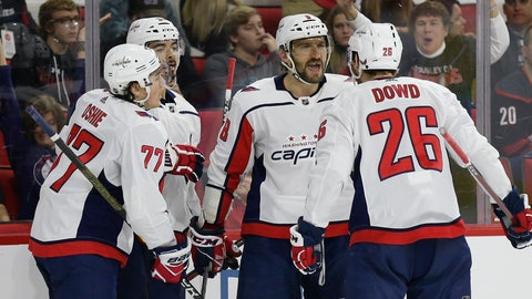 <p>               Washington Capitals' Alex Ovechkin (8), of Russia, celebrates his goal against the Carolina Hurricanes with T.J. Oshie (77), Nic Dowd (26) and Jonas Siegenthaler, of the Czech Republic, during the second period of an NHL hockey game in Raleigh, N.C., Friday, Dec. 14, 2018. (AP Photo/Gerry Broome)             </p>