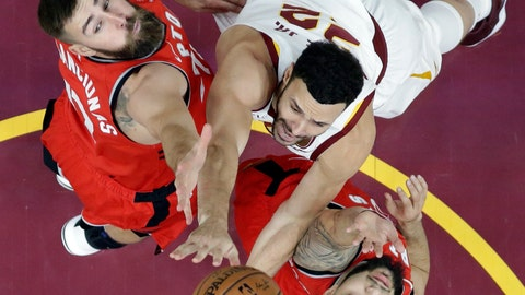 <p>               Cleveland Cavaliers' Larry Nance Jr., center, drives to the basket against Toronto Raptors' Jonas Valanciunas, left, from Lithuania, and Fred VanVleet in the first half of an NBA basketball game, Saturday, Dec. 1, 2018, in Cleveland. (AP Photo/Tony Dejak)             </p>