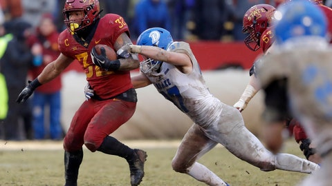 <p>               Iowa State running back David Montgomery tries to break a tackle by Drake linebacker Connor Willis, right, during the first half of an NCAA college football game, Saturday, Dec. 1, 2018, in Ames, Iowa. (AP Photo/Charlie Neibergall)             </p>