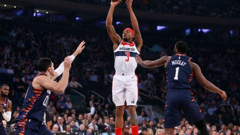 <p>               Washington Wizards' Bradley Beal (3) shoots over New York Knicks' Enes Kanter, of Turkey, (00) and New York Knicks' Emmanuel Mudiay, of Congo, (1) during the first quarter of an NBA basketball game Monday, Dec. 3, 2018, in New York. (AP Photo/Jason DeCrow)             </p>