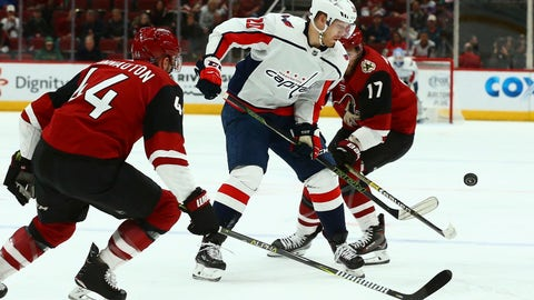 <p>               Washington Capitals center Lars Eller (20) tries to control the puck between Arizona Coyotes defenseman Kevin Connauton (44) and center Alex Galchenyuk (17) during the first period of an NHL hockey game Thursday, Dec. 6, 2018, in Glendale, Ariz. (AP Photo/Ross D. Franklin)             </p>