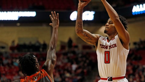 <p>               Texas Tech's Kyler Edwards (0) shoots over Texas-Rio Grande Valley's Javon Levi (14) during the first half of an NCAA college basketball game Friday, Dec. 28, 2018, in Lubbock, Texas. (AP Photo/Brad Tollefson)             </p>