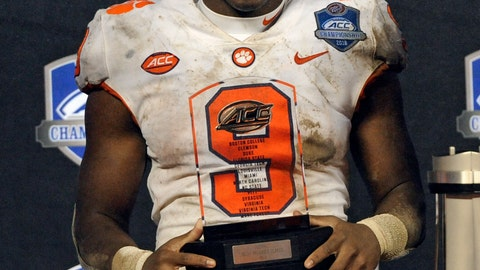 <p>               Clemson's Travis Etienne (9) holds to trophy for being named the game's most valuable player after Clemson defeated Pittsburgh to win the Atlantic Coast Conference championship NCAA college football game in Charlotte, N.C., Saturday, Dec. 1, 2018. (AP Photo/Mike McCarn)             </p>